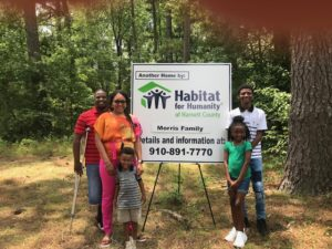Fredrika Morris and Family participate in ground breaking for their new home