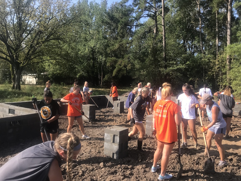 Campbell University Ladies Lax Team volunteers to work on current Habitat home project